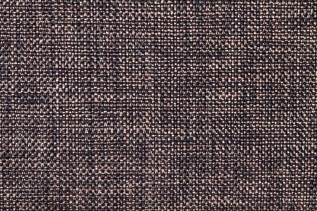 Brown e primo piano nero del fondo del tessuto. struttura della macro di tessuto Foto Premium