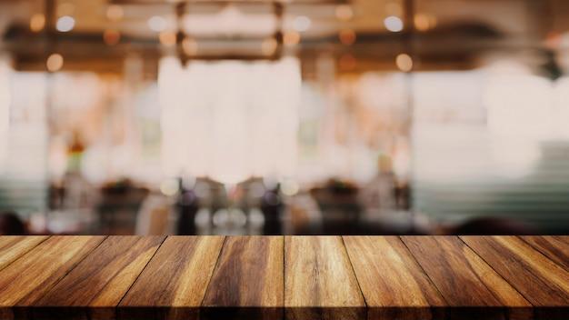 Caffetteria o caffè interni della sfuocatura astratta per fondo. Foto Premium