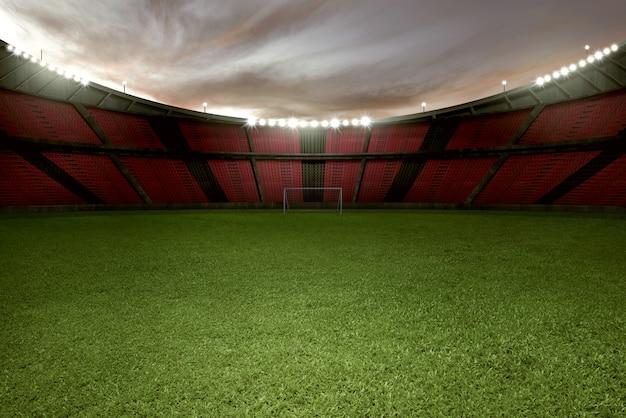 Calcio stadio con erba verde e tribuna vuota Foto Premium