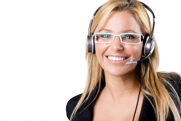 Call center donna bionda con auricolare Foto Gratuite