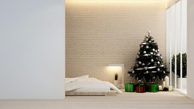 Camera da letto con albero di natale in hotel o appartamento - interior design - rendering 3d Foto Premium