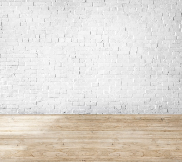 Camera fatta di muro di mattoni e pavimento in legno Foto Gratuite