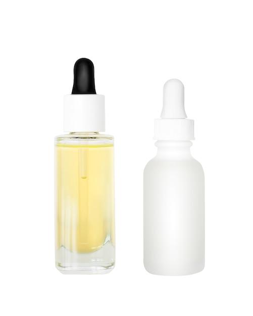 Campione di siero della pelle e olio isolato su bianco Foto Premium