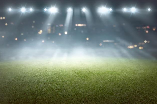 Campo di calcio con riflettori di sfocatura Foto Premium