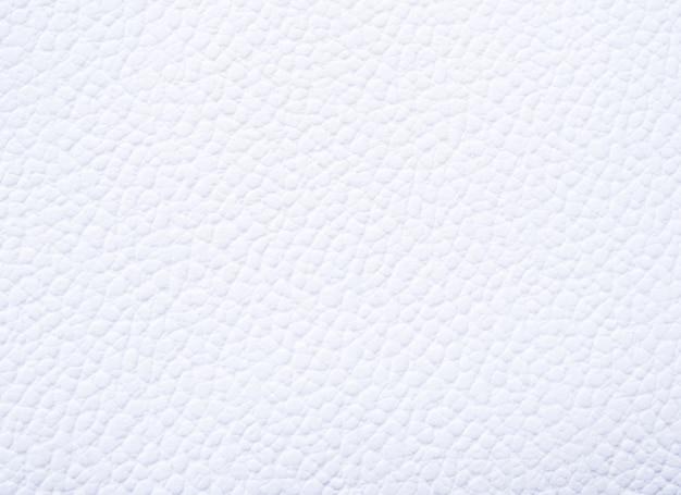 Carta bianca con una trama di superficie ruvida per uno sfondo di progettazione. Foto Premium