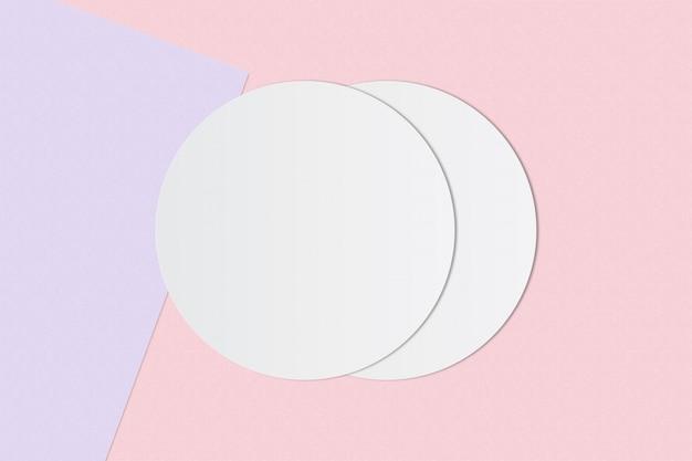 Carta bianca del cerchio e spazio per testo su sfondo di colore pastello Foto Premium