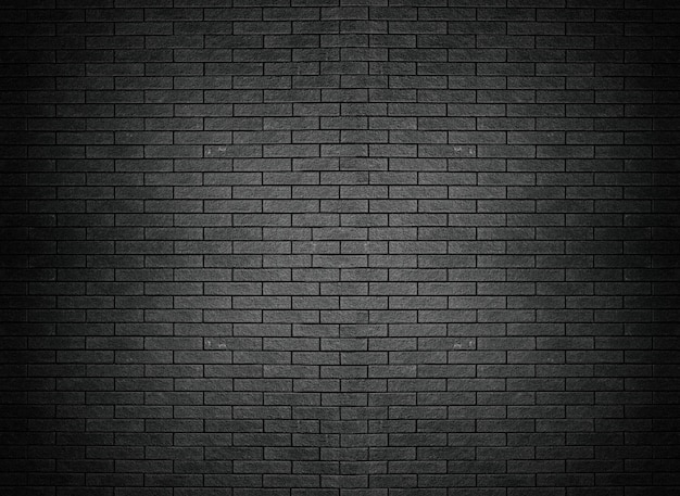 Carta da parati nera del fondo della superficie del mattone di struttura del muro di mattoni Foto Premium