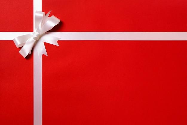 Conosciuto Carta da regalo nastro bianco fiocco di carta sfondo rosso  CD41