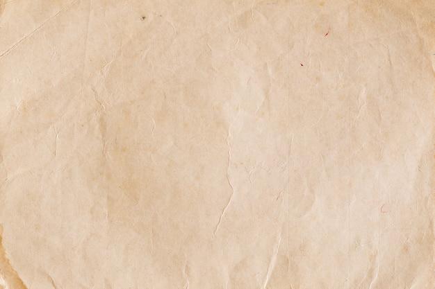 Carta marrone d'annata con le grinze, vecchie strutture di carta astratte per fondo Foto Premium