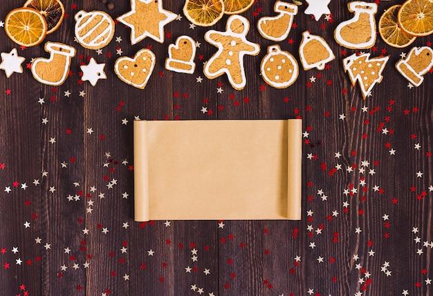 Carta vuota di natale dei biscotti del pan di zenzero per la cannella delle arance del nuovo anno di ricetta Foto Gratuite