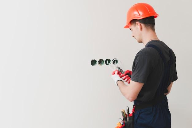 Cavo di taglio riparatore a parete Foto Gratuite