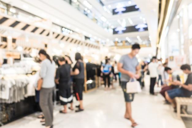 Centro commerciale astratto della sfuocatura e interno del negozio di vendite per fondo Foto Gratuite