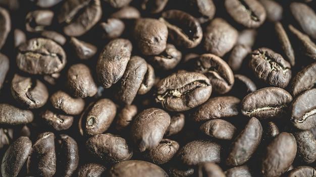 Chicchi di caffè tostati freschi Foto Premium