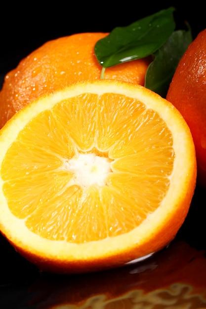 Chiuda in su di frutta arancione fresca Foto Gratuite