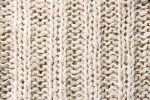 Chiuda in su di struttura lavorata a maglia di lana Foto Premium