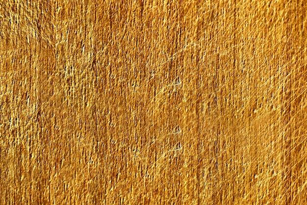 Chiuda in su di una struttura graffiata gialla del muro di cemento Foto Gratuite