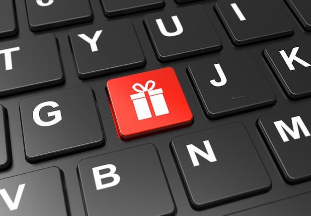 Chiuda sul bottone rosso con il segno del regalo sulla tastiera nera Foto Premium