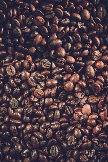Chiuda sul fondo dei chicchi di caffè Foto Premium