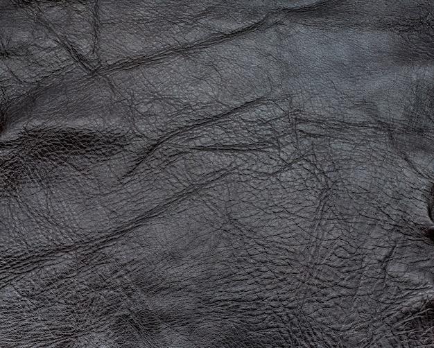 Chiuda sul fondo di cuoio di struttura sgualcito colore di marrone scuro Foto Premium
