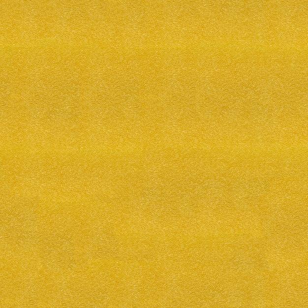 Chiuda sulla vista a struttura gialla della spugna. modello senza soluzione di continuità Foto Premium