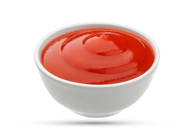 Ciotola del ketchup su bianco Foto Premium