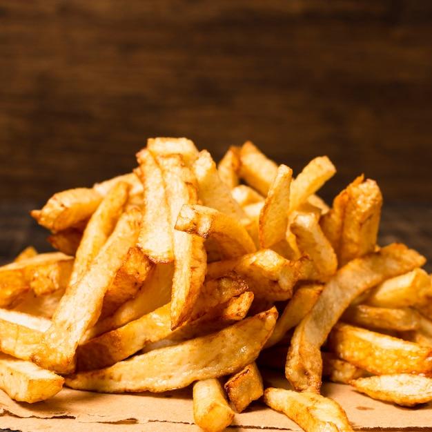 Close-up di patatine fritte dorate Foto Gratuite