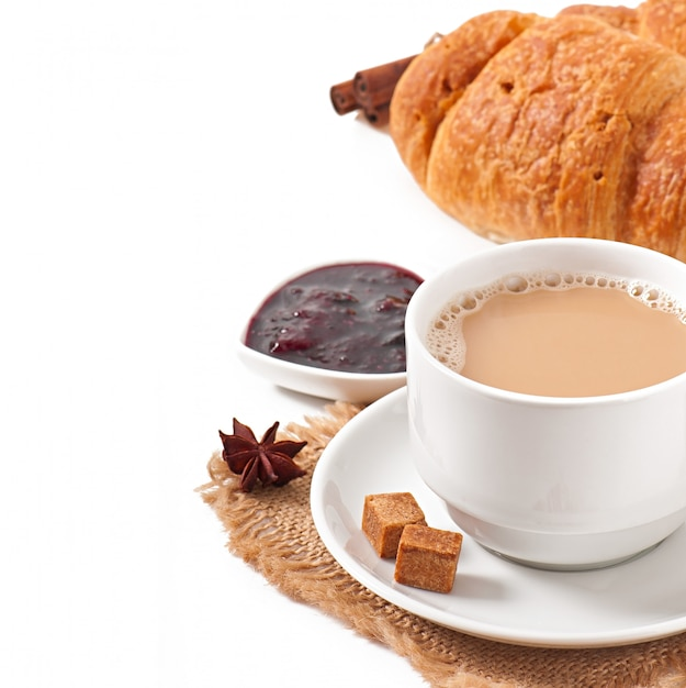 Colazione con caffè e cornetti freschi Foto Gratuite