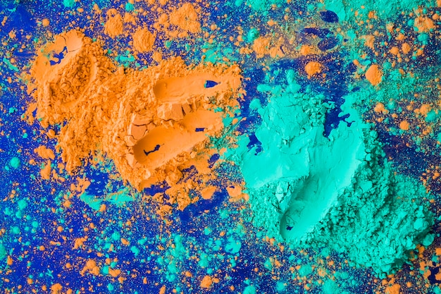 Colore Giallo E Turchese Holi Su Sfondo Blu Scaricare Foto Gratis