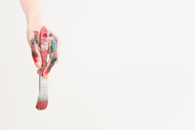 Composizione artistica con vernice e pennello Foto Gratuite
