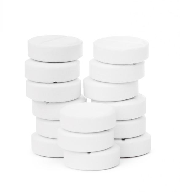 Compressa di pillola medica isolata su bianco Foto Premium