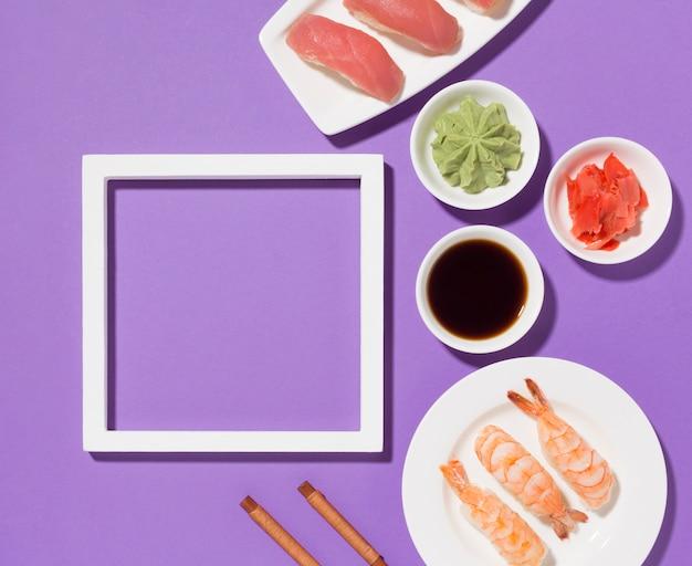 Concetto di giorno di sushi vista dall'alto con cornice Foto Gratuite