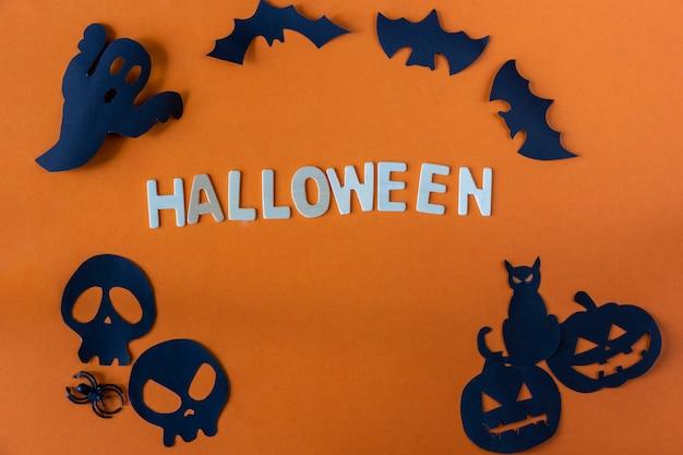 Concetto di halloween su sfondo arancione Foto Premium
