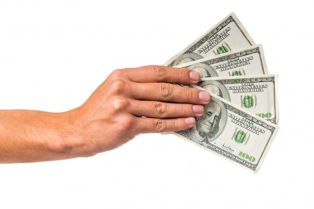 Contanti maschii dei soldi della tenuta della mano isolati Foto Premium