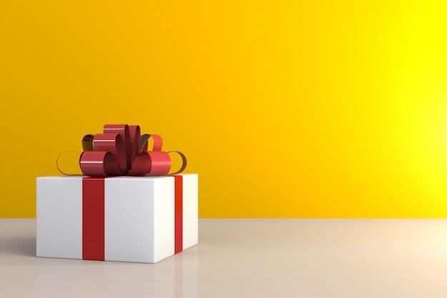 Contenitore di regalo con il nastro rosso sulla tavola di legno, contenitore di regalo bianco su fondo giallo con spazio Foto Premium