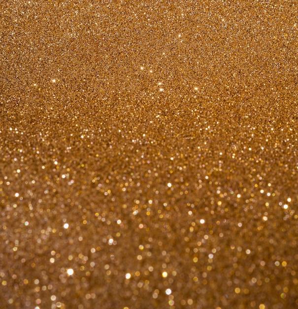 Copia spazio lucido sfocato sfondo oro Foto Gratuite