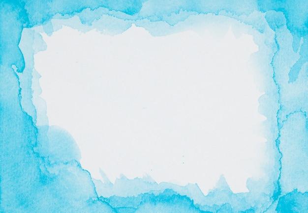 Cornice blu di vernici su foglio bianco Foto Gratuite