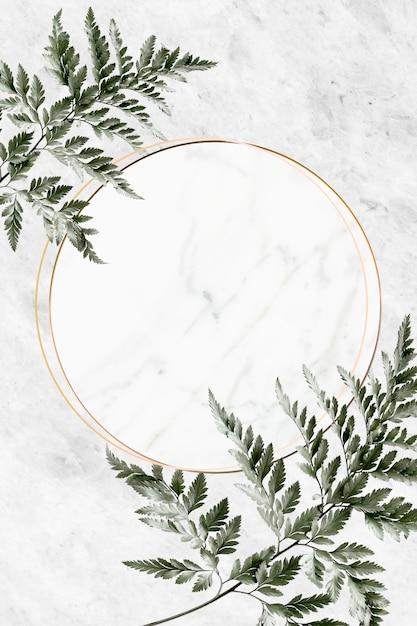Cornice dorata su sfondo di marmo Foto Premium