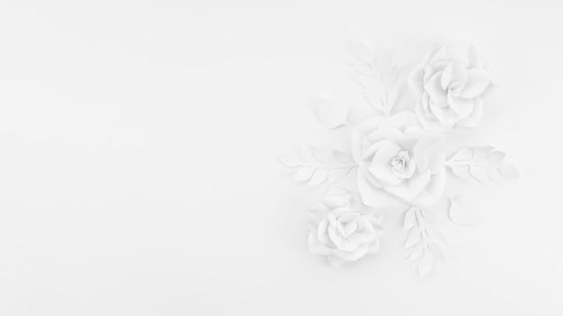 Cornice vista dall'alto con fiori di carta bianca e lo sfondo Foto Gratuite