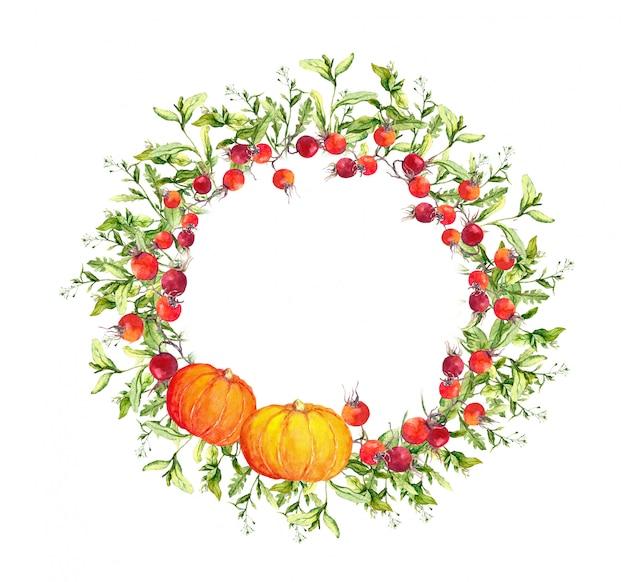 Corona del ringraziamento - zucche, bacche, foglie di autunno. bordo rotondo dell'acquerello Foto Premium