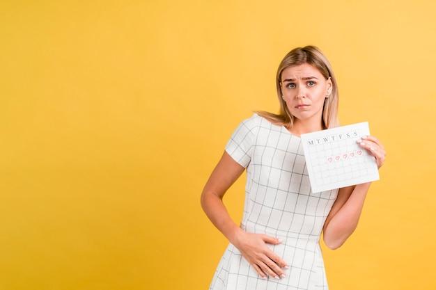 Crampi perché mestruazioni e calendario mestruale Foto Gratuite