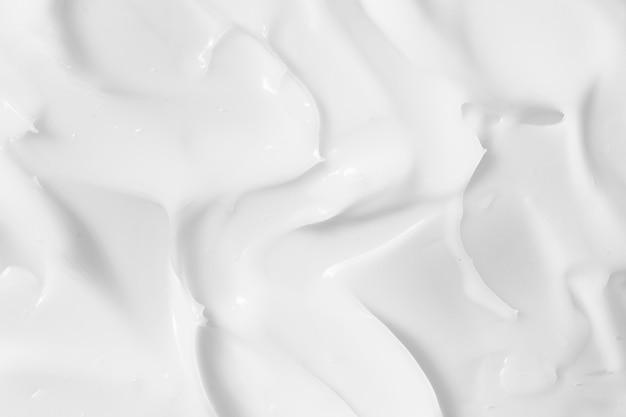 Crema cosmetica bianca, crema idratante, fondo di struttura della lozione Foto Premium