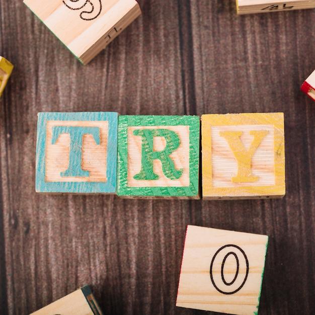 Cubi di legno con titolo di prova Foto Gratuite