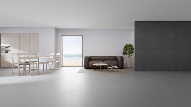 Cucina vista mare, sala da pranzo e soggiorno di casa sulla spiaggia di lusso dal design moderno. Foto Premium