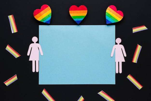Cuori arcobaleno con icona di coppia lesbica e carta Foto Gratuite