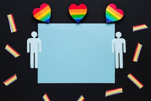 Cuori arcobaleno con icone di coppia gay e carta Foto Gratuite