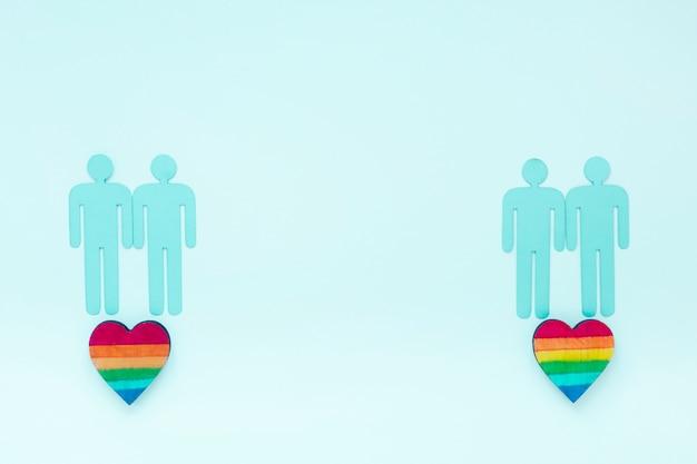 Cuori arcobaleno con icone di coppie gay Foto Gratuite