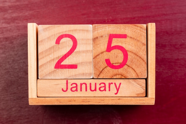 Data di legno per il nuovo anno cinese su fondo rosso Foto Gratuite