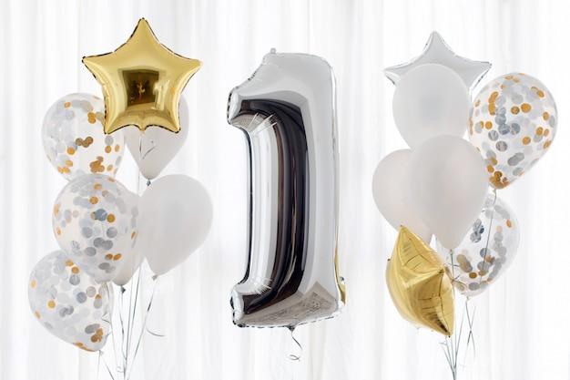 Decorazione per 1 anni di compleanno, anniversario Foto Premium