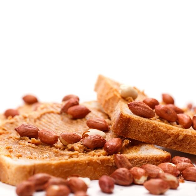 Delizioso burro di arachidi sul tavolo Foto Gratuite