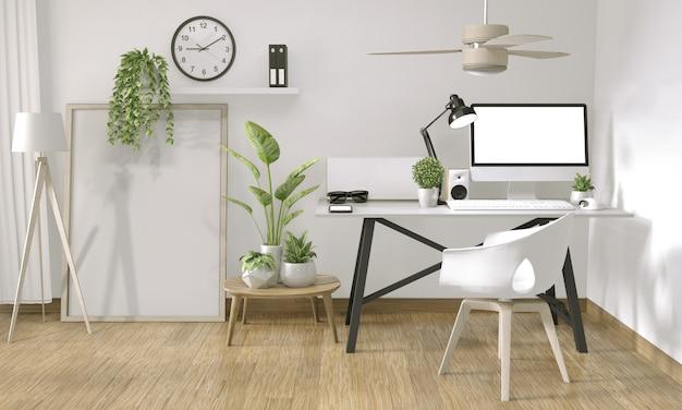 Derida sul computer del manifesto nello stile e nella decorazione di zen dell'ufficio sull'ufficio della tavola superiore Foto Premium